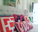 global-inspired-accent-pillows-bedroom-trina-turk-honeycomb-anthropologie-bedding-patterns-pouf-home-decor-trends