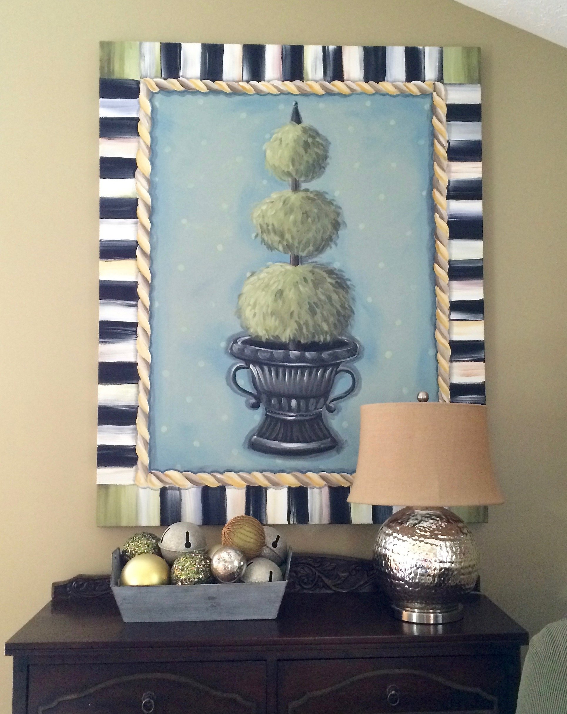 topiary canvas art with black and white border