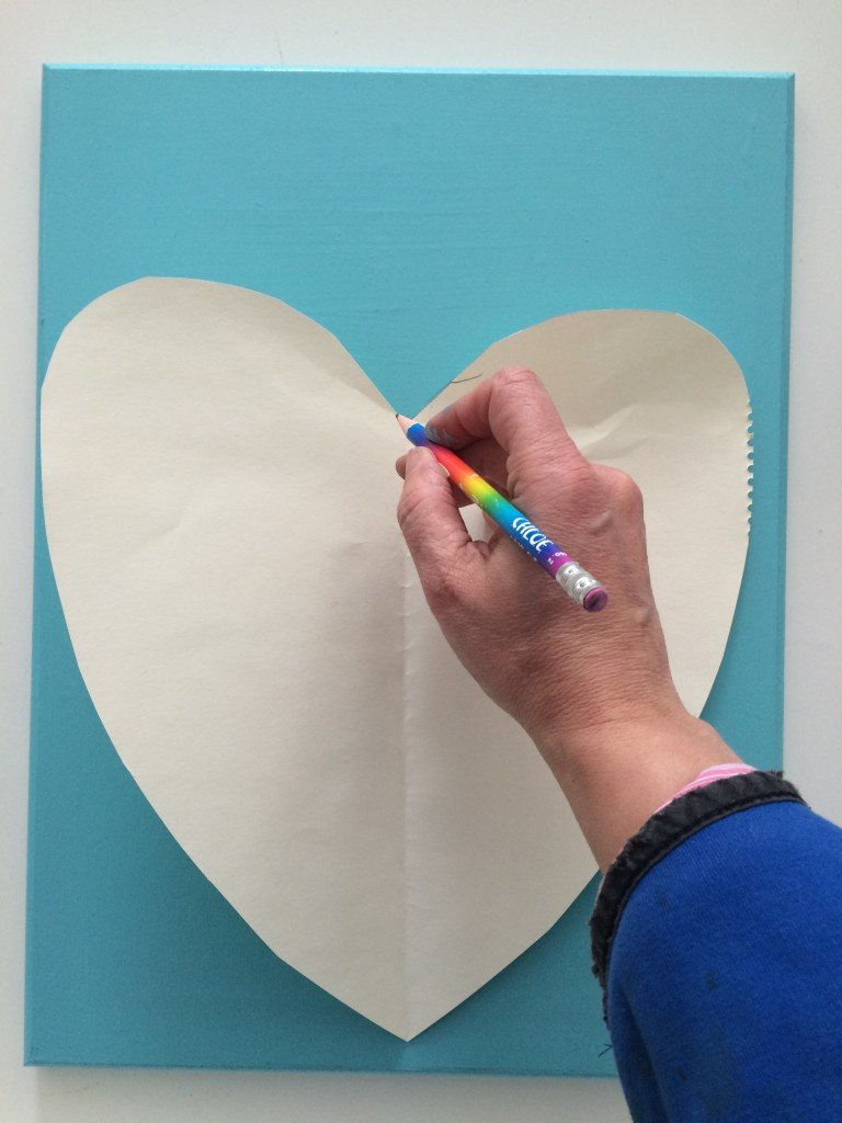 an way way to trace a heart is to fold a paper in half to make a template
