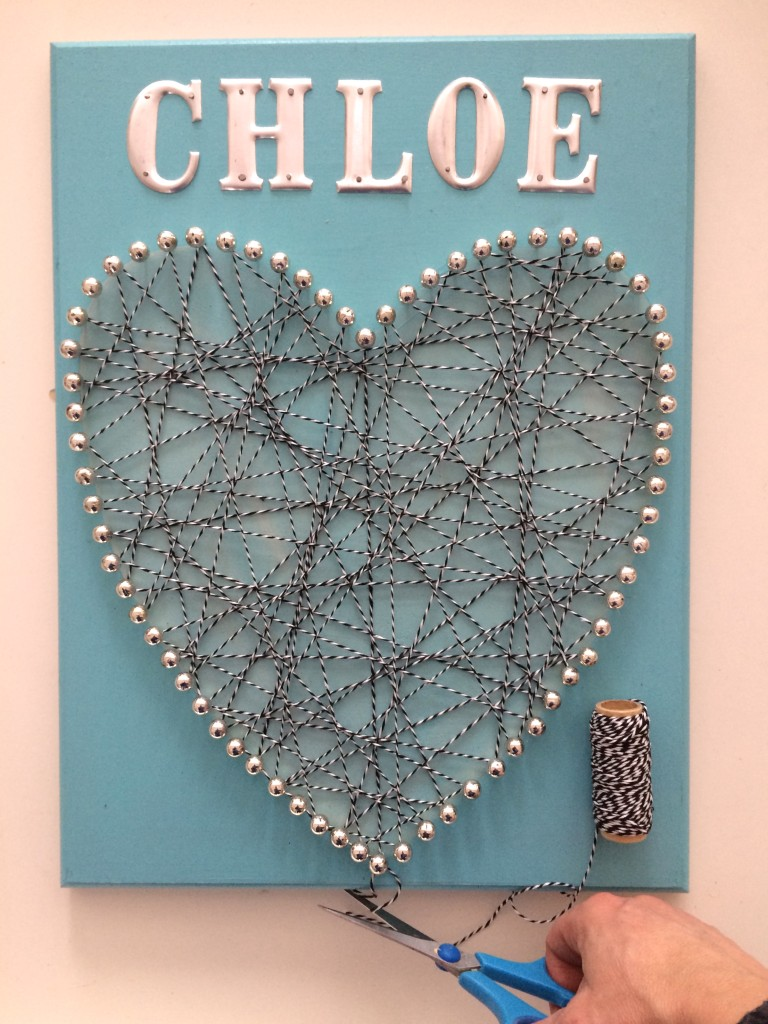 DIY valentines day memo board using push pins, twine and metal letters