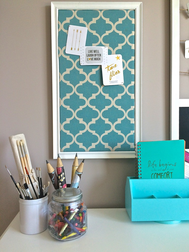 Dollar store oversized pencils get a fresh look by covering them with scrapbook papers.