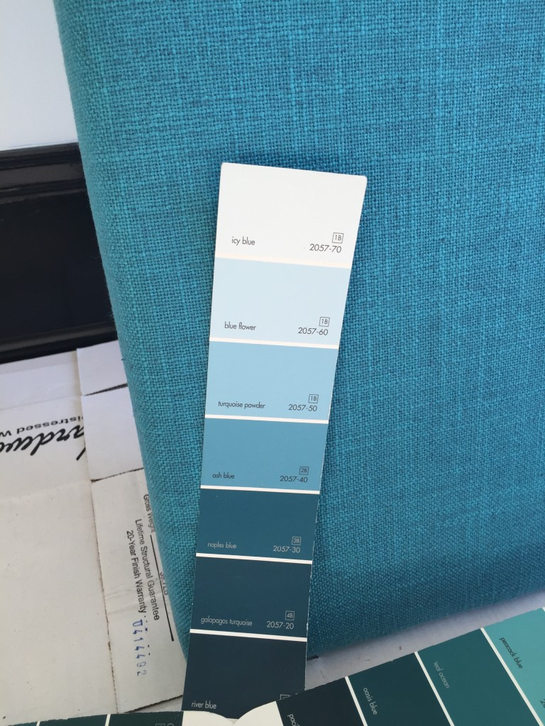 matching the paint swatches to a turquoise linen upholstered headboard