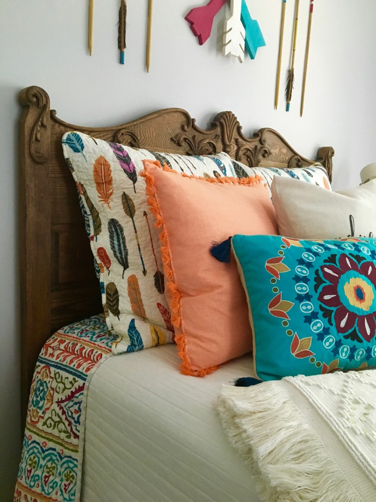 boho_chic_bohemian_bedding_bedroom_teen_makeover_elepahont_decor_adventure_bedding_arrows_Gallery_wall_wooden_rustic_HOmeGoods_antique_bed_feathers_accent_