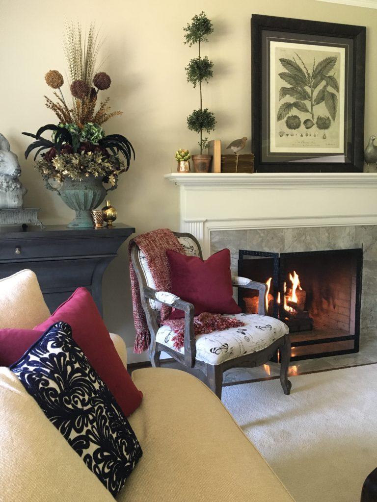 fall_ideas_textures_poufs_neutral_decor_monarch_accent_chair_decorating_home_decor_monarch_chair_fireplace_mantel_livingroom_formal_floral_arrangement_merlot_burgundy_wisteria