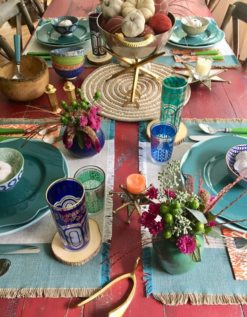 thanksgiving_friendsgiving_setting_the_table_boho_chic_gold_wishbone_glasses_world_market_pumpkin_centerpieces_flowers