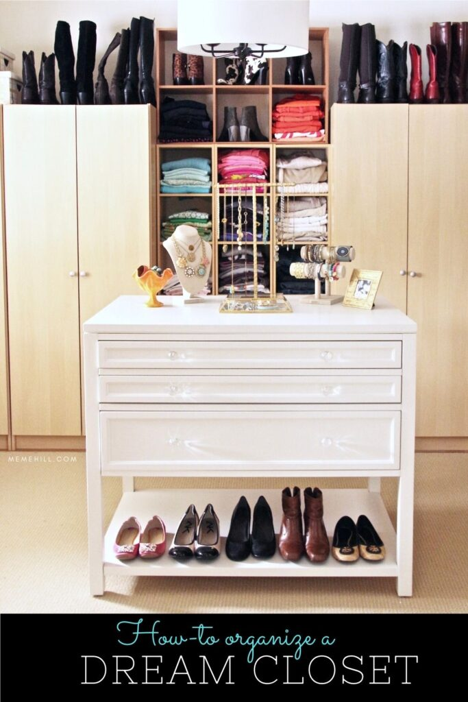 color coded clothes are arranged in this big walk in closet , jewelry organization