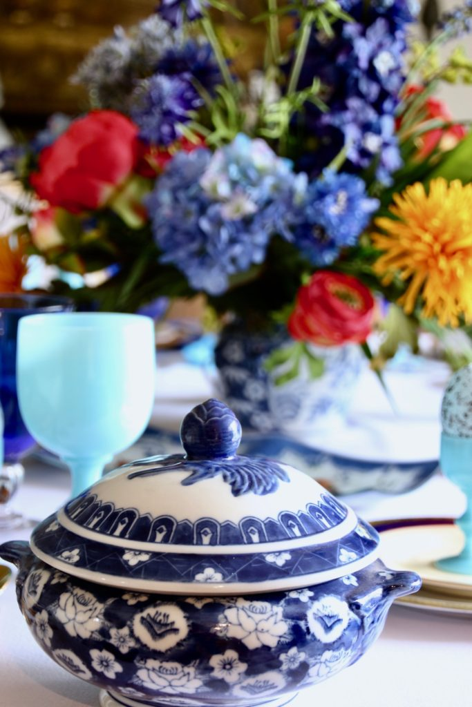Tradtional_home_Easter_tablescape_setting_table_round_color_modern_mix_floral_arrangement_cobalt_delft_blue_dinnerware_dining_room_tureen