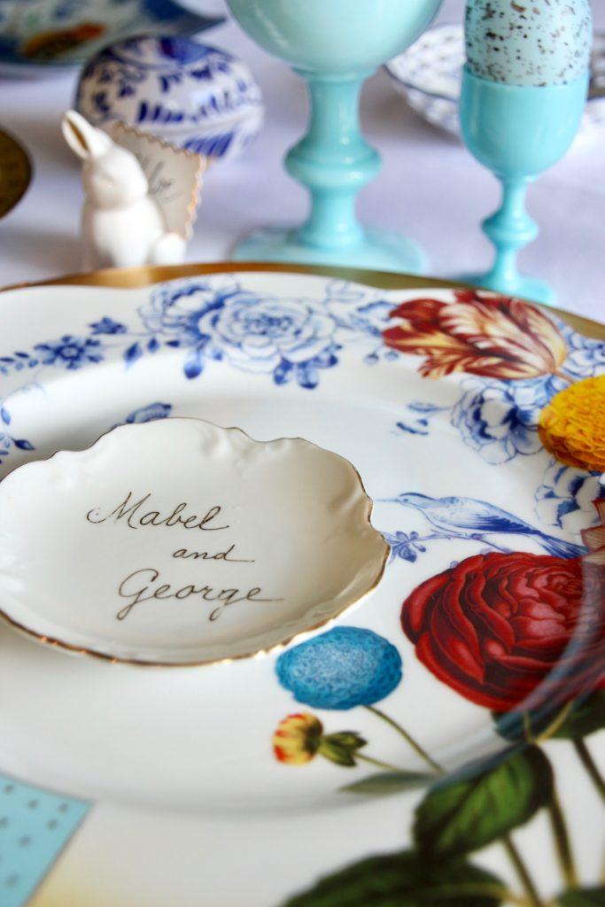 Tradtional_home_Easter_tablescape_setting_table_round_color_modern_mix_floral_arrangement_cobalt_delft_blue_dinnerware_dining_room_vintage_plate_amara_pip_studio