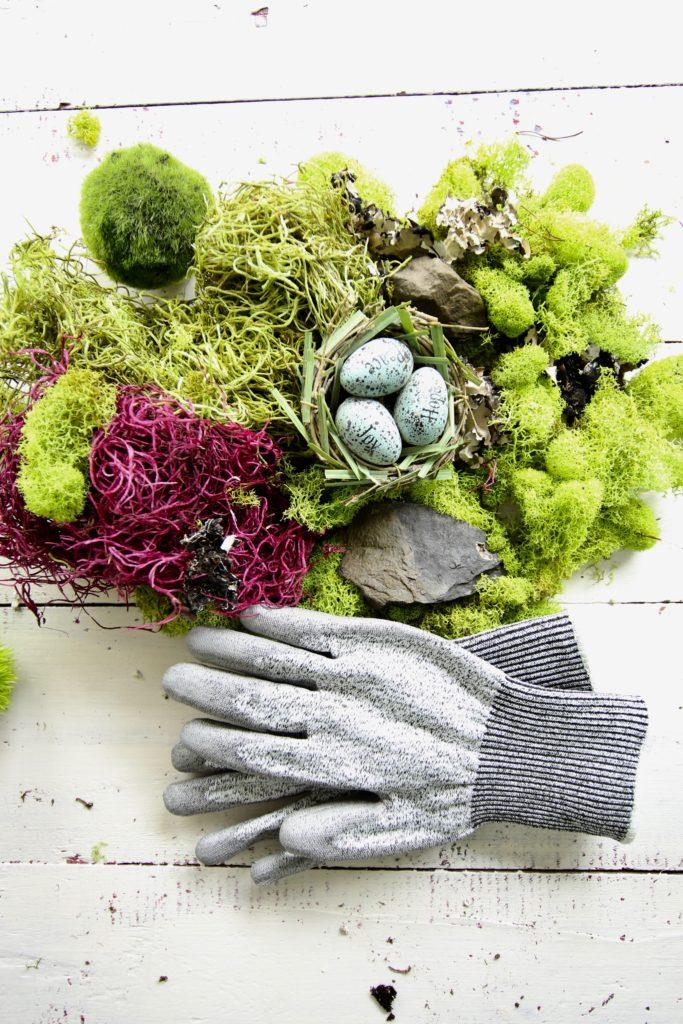 gerbera_daisies_container_garden_spring_easter_planter_flowers_white_moss_rabbits_gloves_gardening_egg_nest