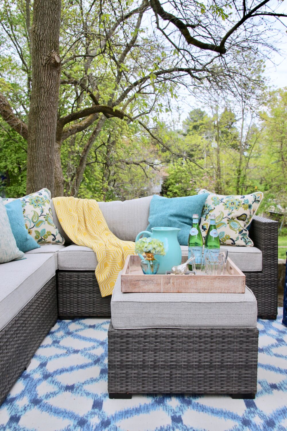 space_patio_space_solutions_outdoor_entertaining_Raymour_flanigan_sofa_homegood_pillows_turquoise_ottoman_tray
