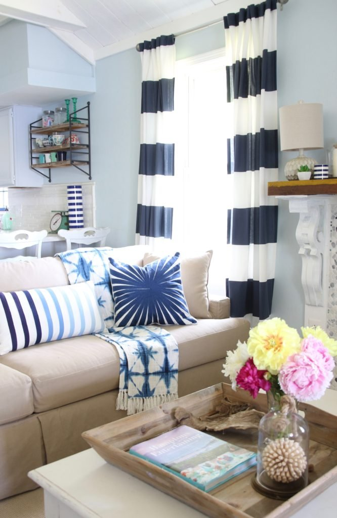 blue and white striped curtains from Homegoods , nautical striped pillows
