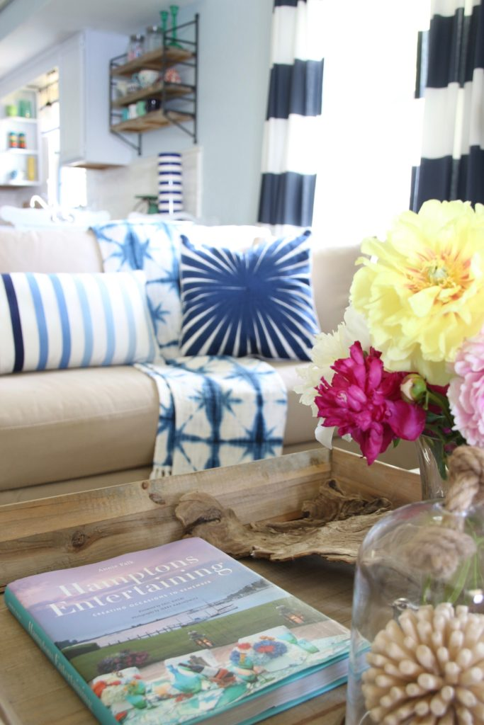 Summer peonies in a vase and a coffee table book