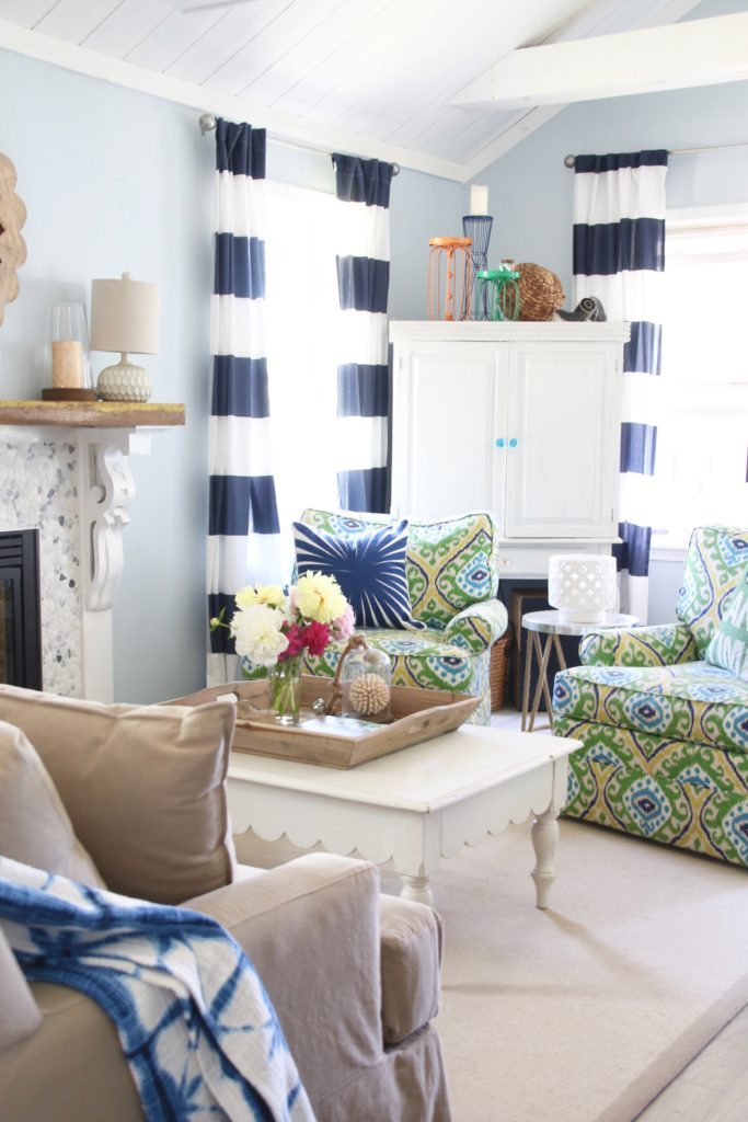 bright colored patterned furniture in a summer cottage