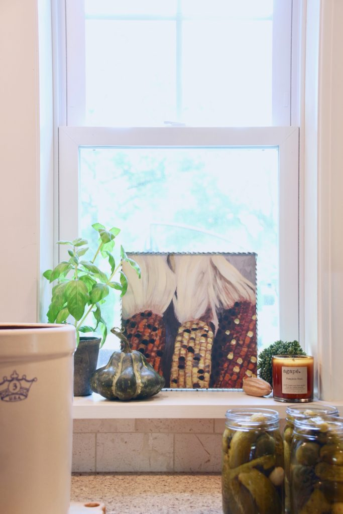 Fall_Blogger_home_tour_living_room_neutral_decor_autumn_colors_meme_hill_Amie_freling_HomeGoods_agape_candle_canning_pickles_corn_art_gourd_mason_jar_candle_window_sill