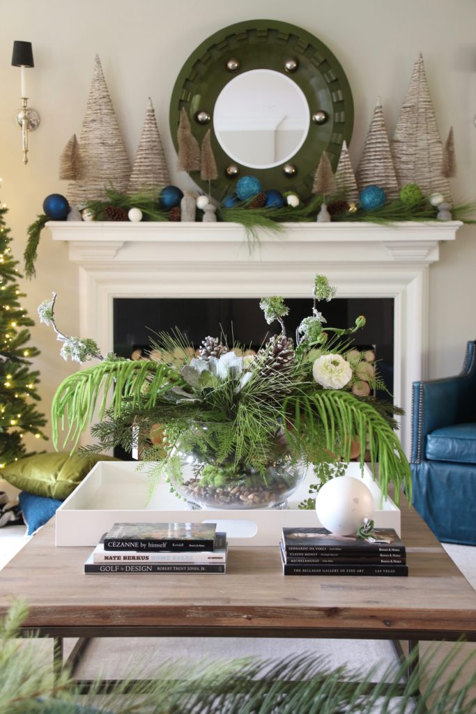 Christmas_blogger_home_tour_meme_hill_studio_light-Up_houses_decorating_holiday_accent_pillows_mackenzie_childs_Stockings_fireplace_mantel_green_garland_bottlebrush_trees