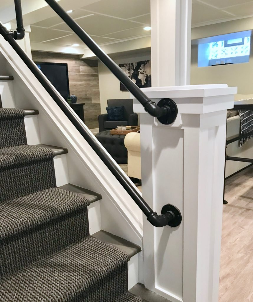 detail of the hand made iron railing in this farmhouse style basement renovation