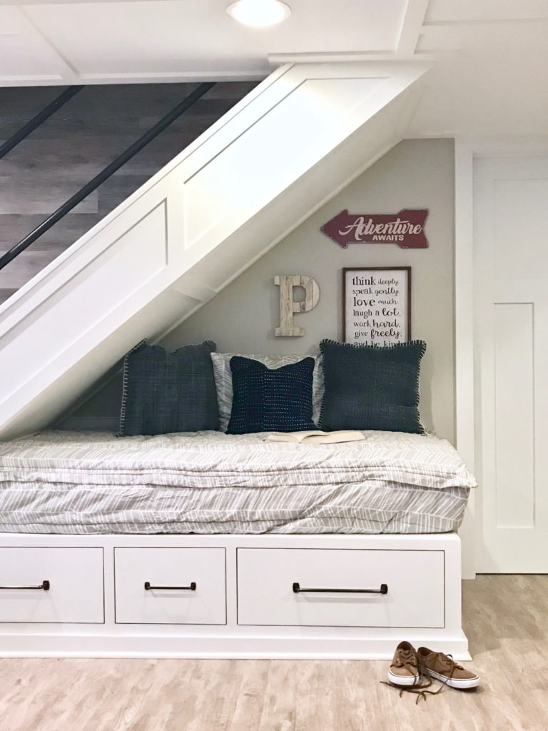 Ma twin bed fits under the stairs and created a reading nook using buddy's bed mattress cover and accent pillows