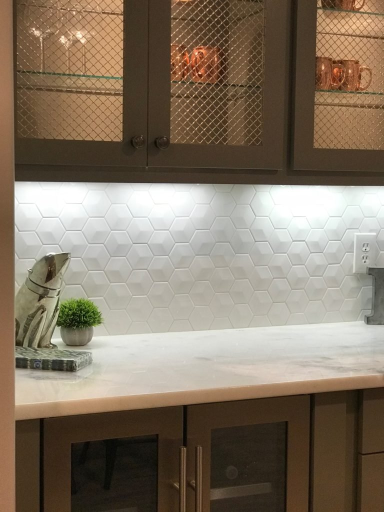 White Hexagon Tiles As A Backsplash And Marble Countertop