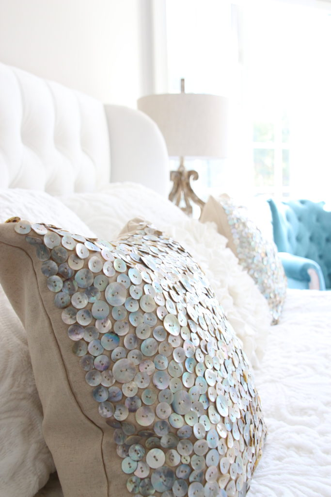 Meme_HIll_studio_amie_Freling_Raymour_flanigan_White_glam_bedroom_gorgeous_Thayer_upolstered_bed_accent_pillows_Dialia_mirrored_nightstand_tierney_round_Shepard_lamp_Dialia_pillow