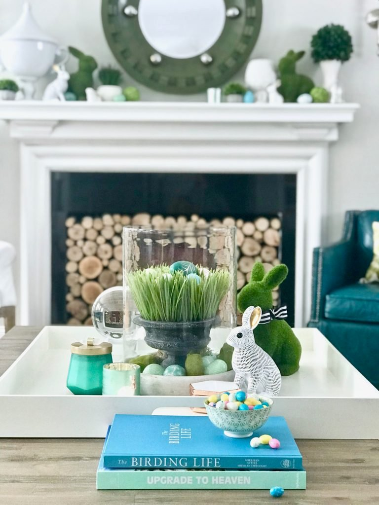 Meme_HIll_Studio_Amie_freling_easter_decorating_livingroom_colorful_ideas_pillows_homeGoods_art_flowers_sofa_white_slipcovered_books_styling