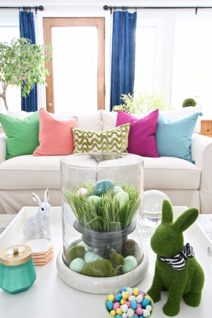 Meme_HIll_Studio_Amie_freling_easter_decorating_livingroom_colorful_ideas_pillows_homeGoods_art_flowers_sofa_white_slipcovered_tablescape_rabbit