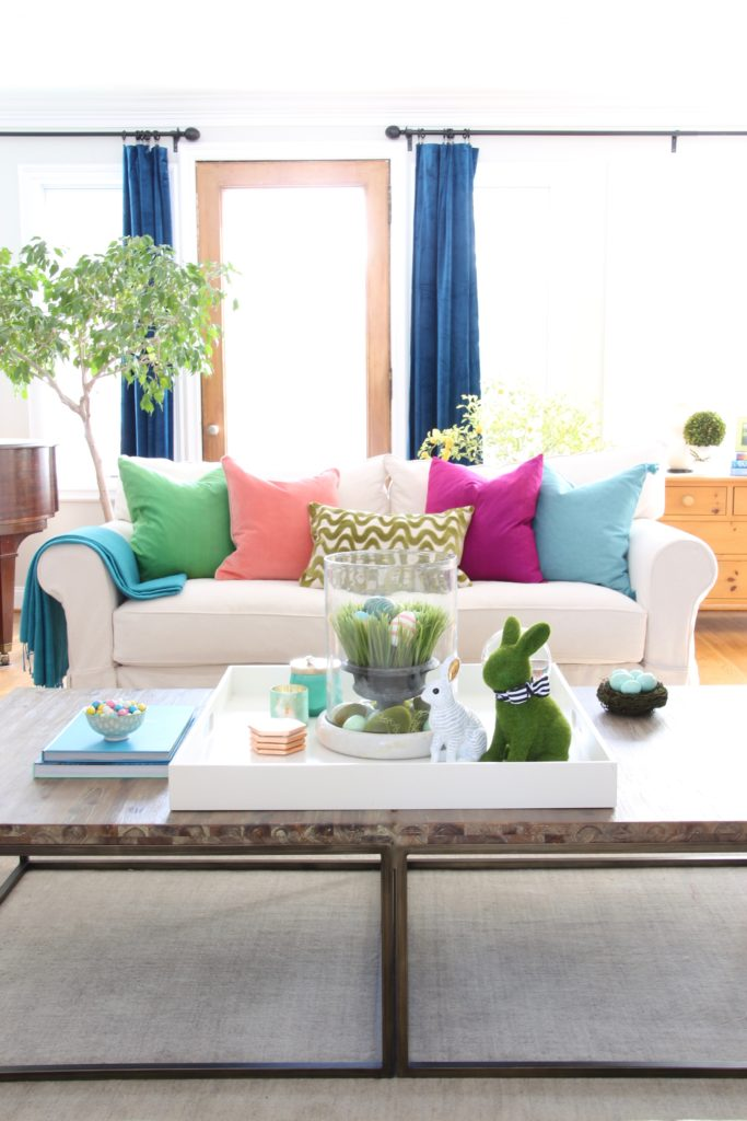 Meme_HIll_Studio_Amie_freling_easter_decorating_livingroom_colorful_ideas_pillows_homeGoods_art_flowers_sofa_white_slipcovered_velvet