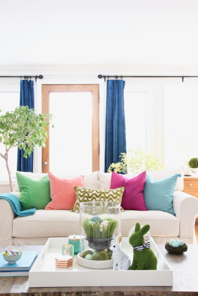 Meme_HIll_Studio_Amie_freling_easter_decorating_livingroom_colorful_ideas_pillows_homeGoods_art_flowers_sofa_white_slipcovered_velvet_curtains_rabbit