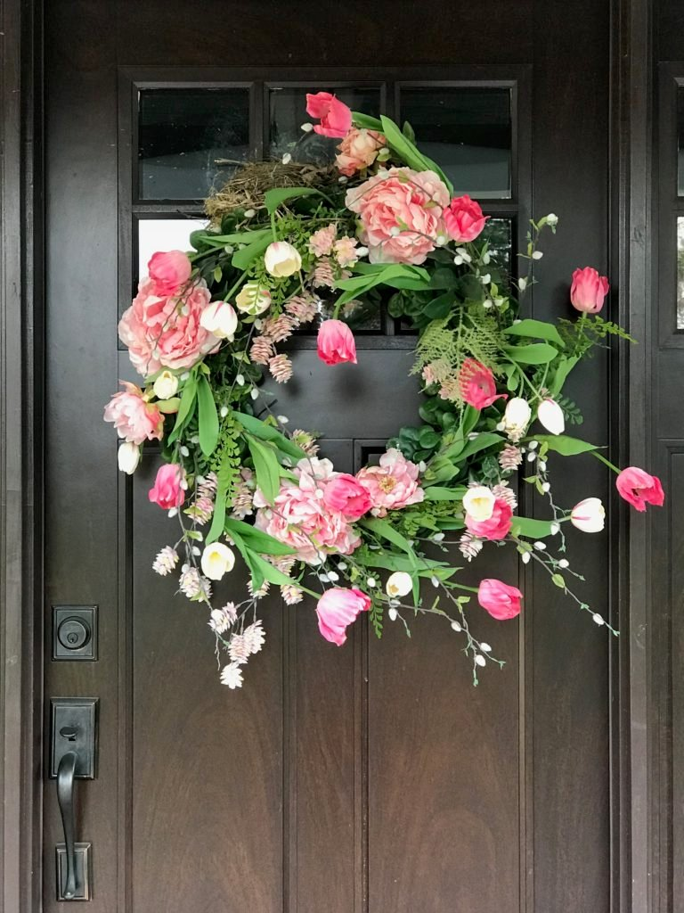 a pink tulip wreath on a dark front door, Spring wreaths from Wisteria