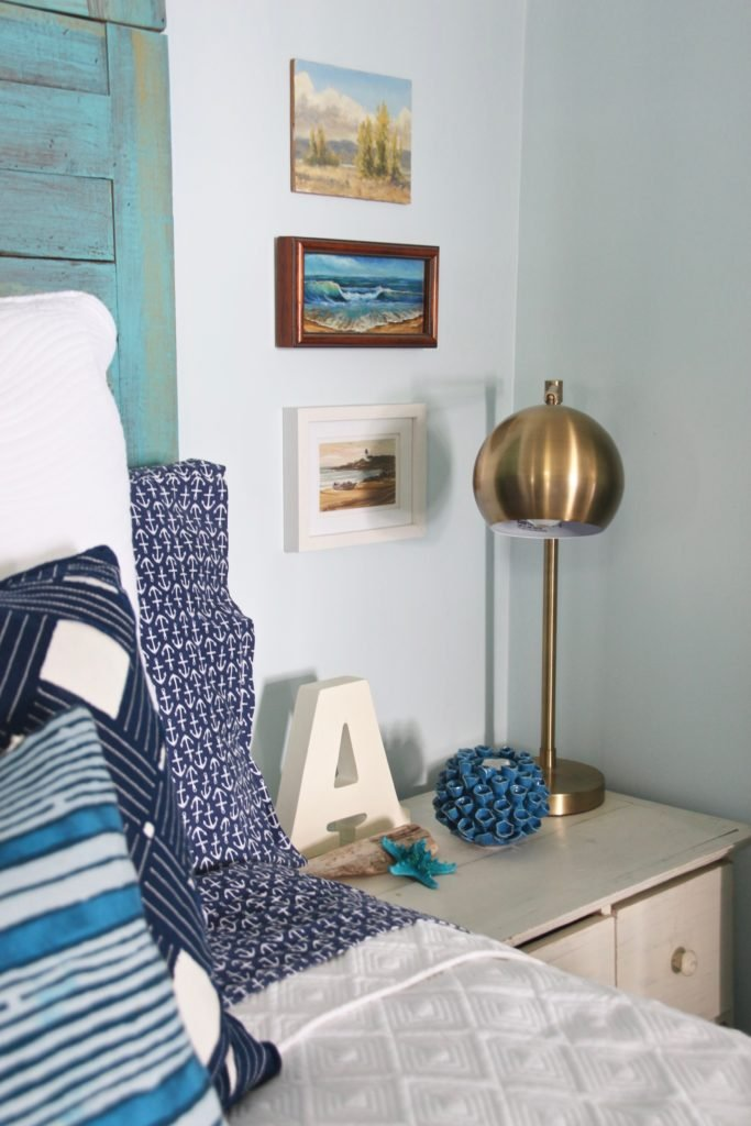 brass bedside lamps, beach artwork, nautical bedding and decor