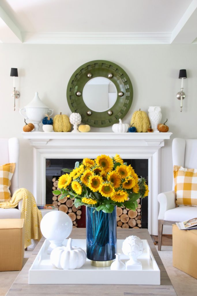 pretty blue vases, fall living room decorating ideas HomeGoods, fireplace mantel decor