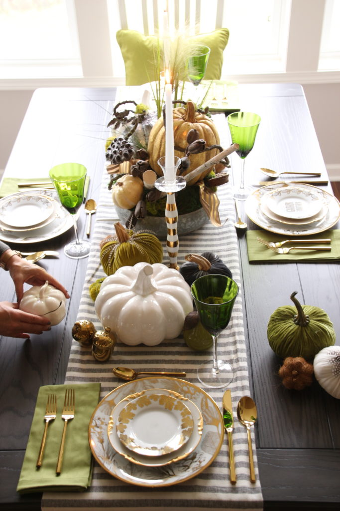 setting a pretty Thanksgiving day table., striped table runners, velvet pumpkins