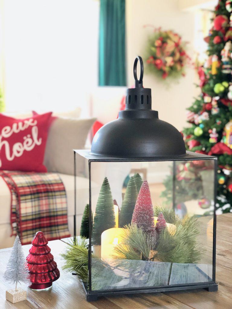 christmas centerpieces, glass and iron lanterns, bottle brush trees, mercury glass