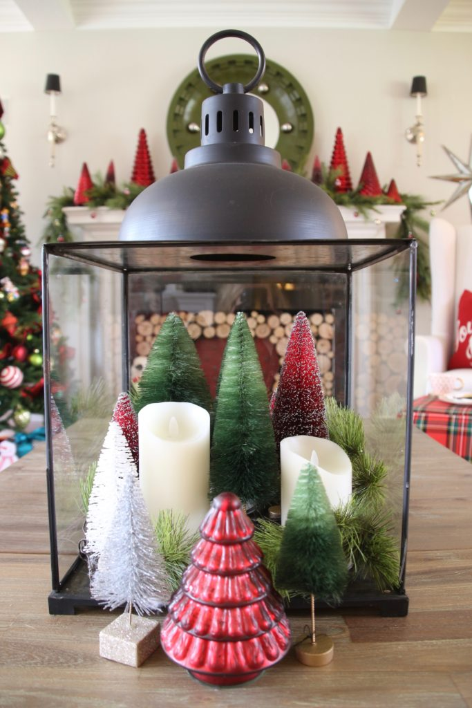 christmas centerpieces, glass and iron lanterns, bottle brush trees