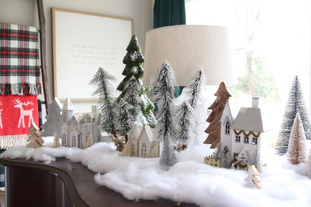 tiny white christmas villages, bottle brush trees, flocked mini trees