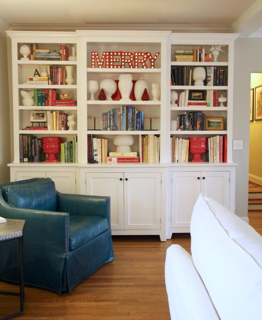 styling bookcases for Christmas, pretty white bookcases, adding christmas decor to built-ins
