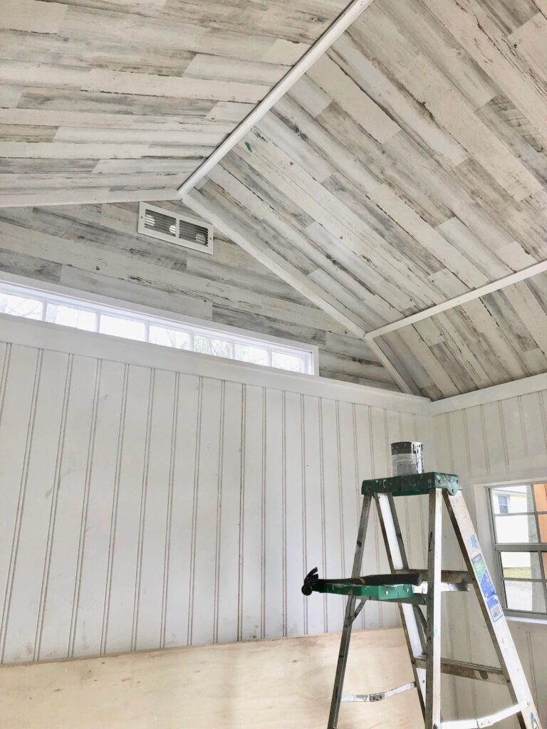 cutting headboard paneling , home depot headboard, shiplap paneling, reclaimed wood paneling, transom window in a shed, inexpensive paneling