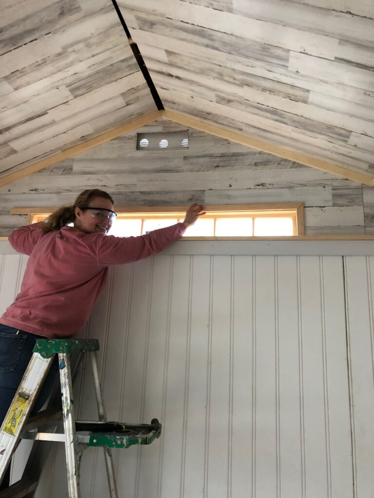 cutting headboard paneling , home depot beadboard, shiplap paneling, reclaimed wood paneling, transom window in a shed