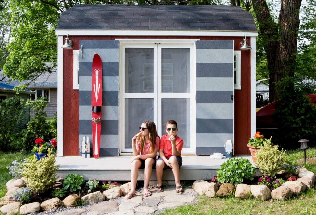 shed turned bunkhouse, she shed ideas, bunkhouse ideas and plans, home depot sheds, cute sheds, painting a shed, windows in a shed, double doors