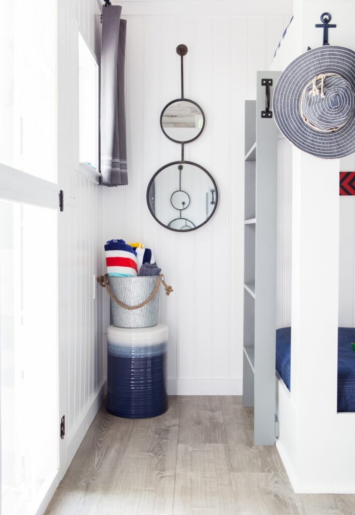 I found the perfect nautical inspired double mirrors that are perfect for the bunkhouse. They remind me a a porthole.