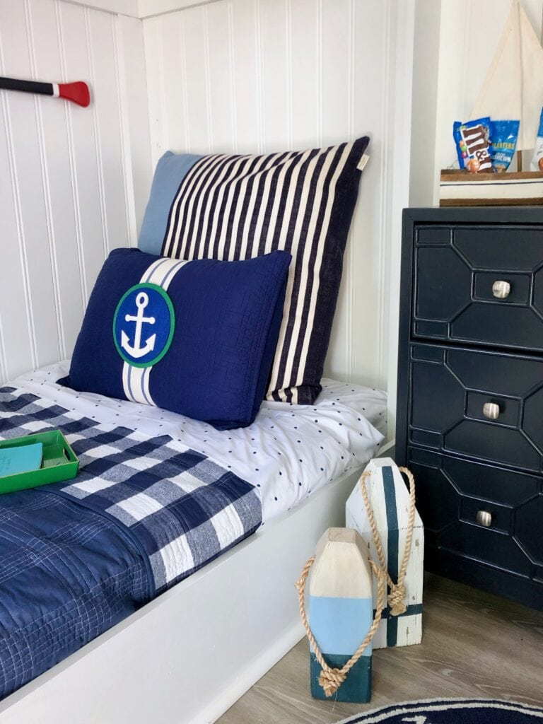 What s pillow candy. How to layer on navy blue bedding. How to mix and match patterns right.