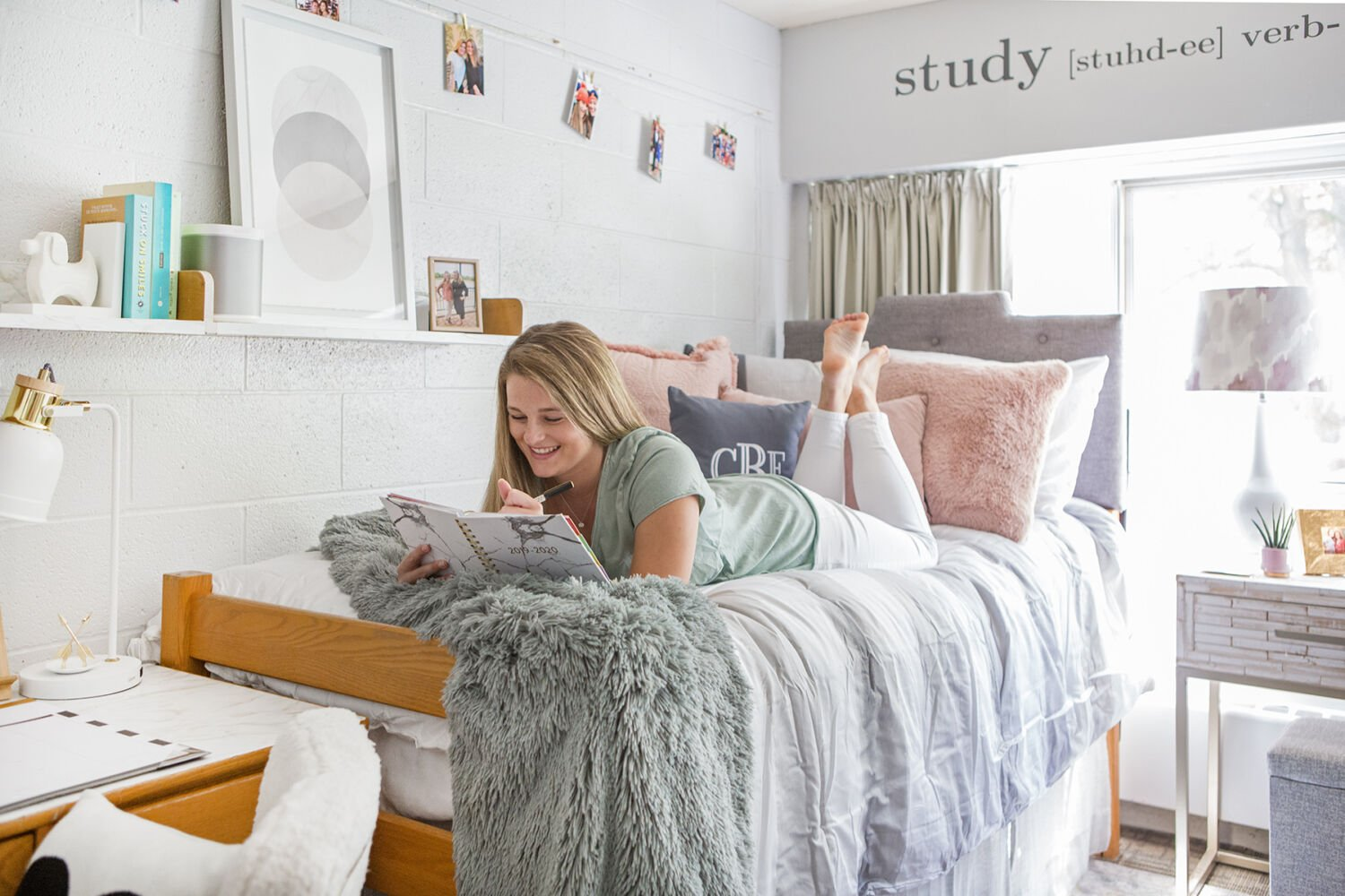 Making a freshman dorm room cozy and comfortable at Ithaca College with pretty bedding and personalized items from home