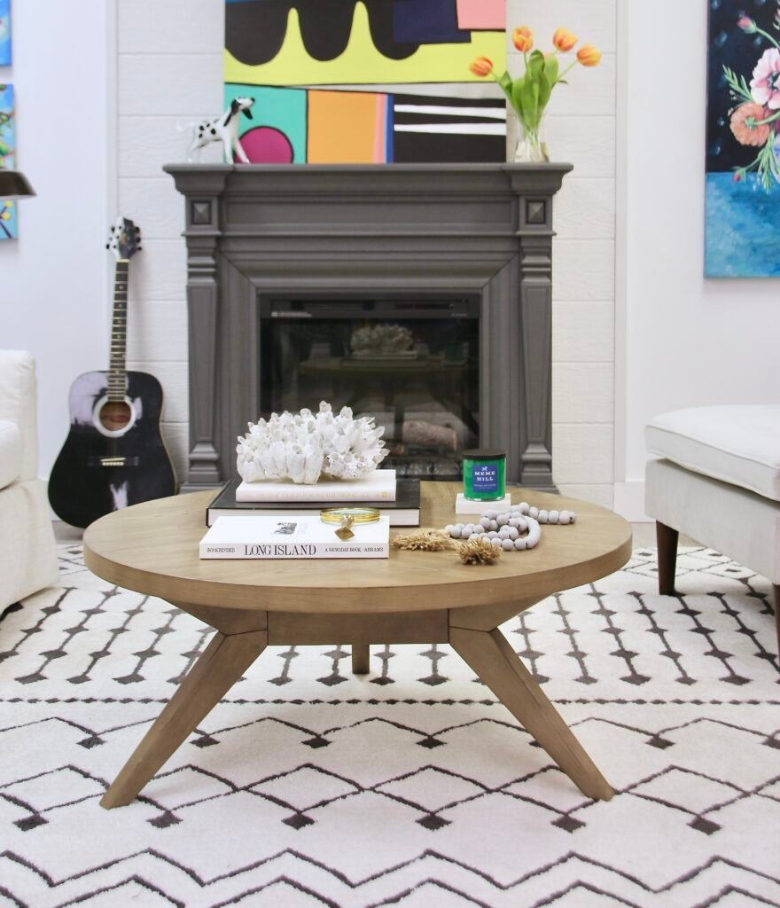 the Nora coffee table from Raymour & Flanigan furniture is the centerpiece of this living room space