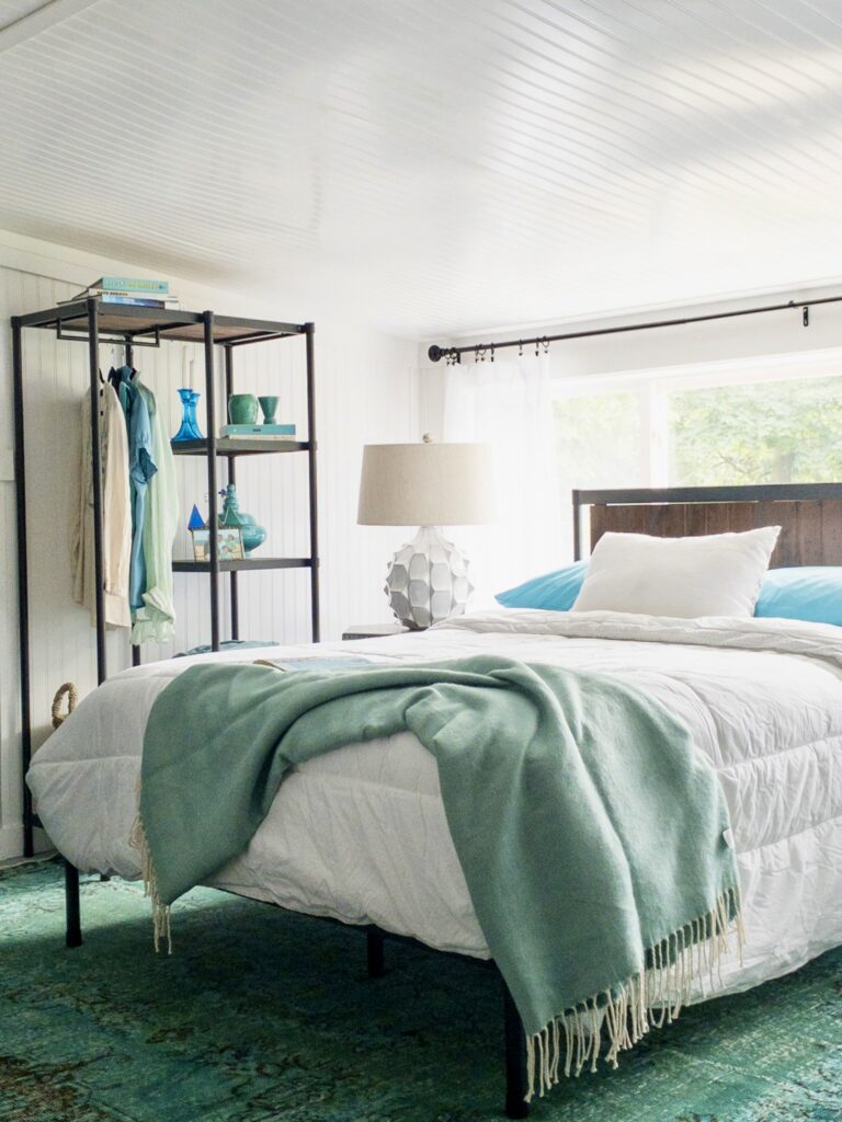 The Wesley Industrial Modern platform bed and etagere with hanging storage