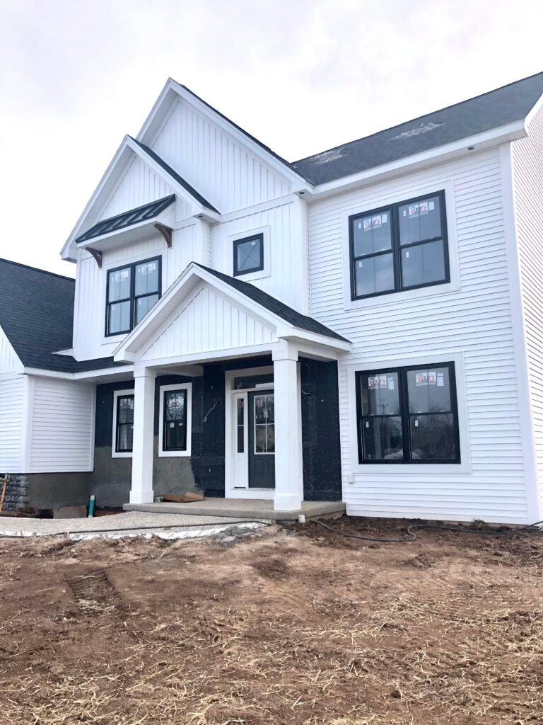 exterior white farmhouse, waiting on the landscaping