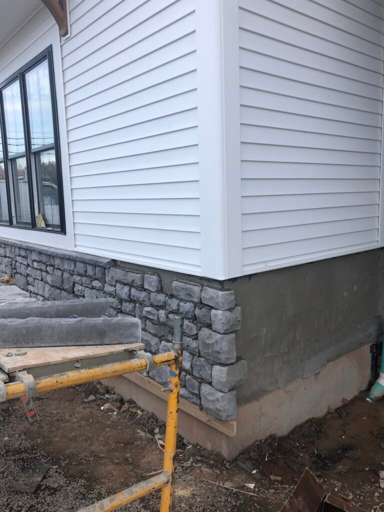 plygem Cobble Shade Mountain stone is going up on the piper Meadows model home in victor ny