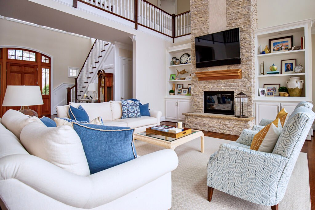 lake house two story living room, tow story stacked stone fireplace