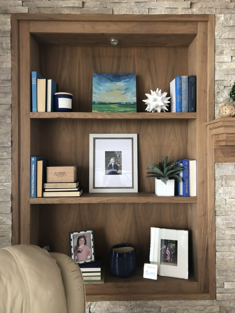 how to style a bookcase, mixing picture frames and books, decorating with books