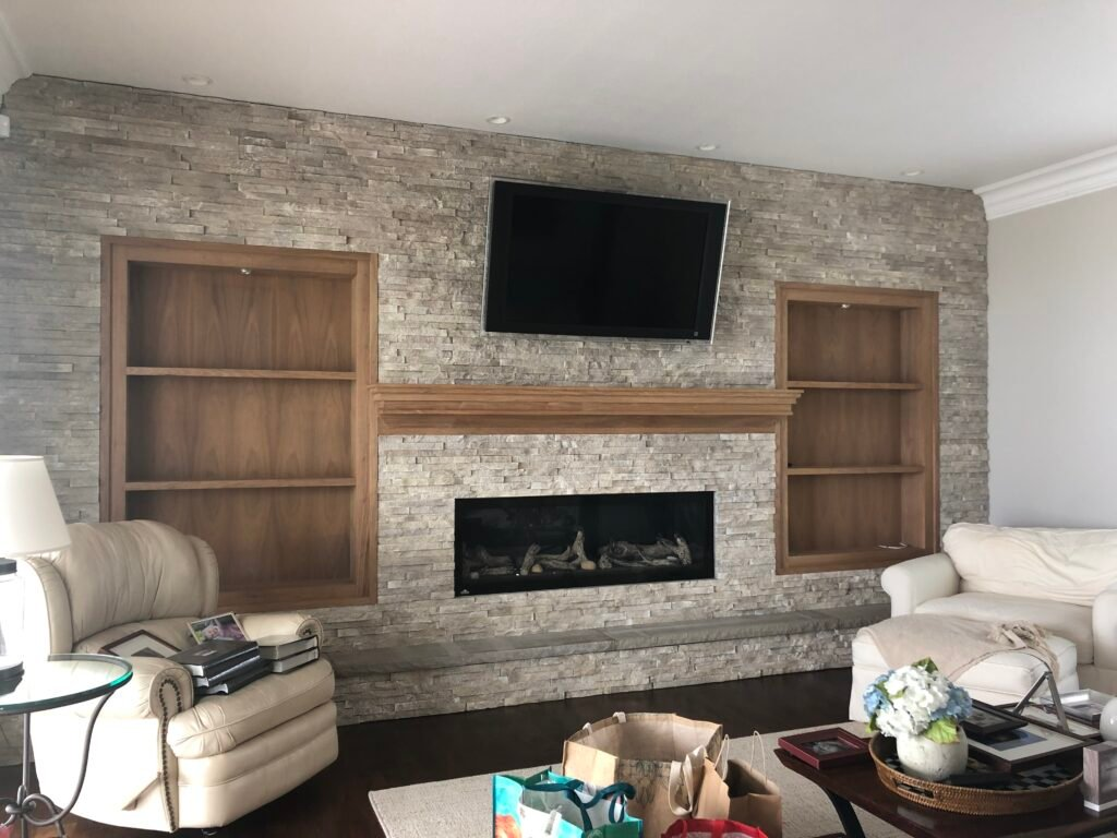wood bookcases, styling shelvies,bookcases on both sides of a fireplace