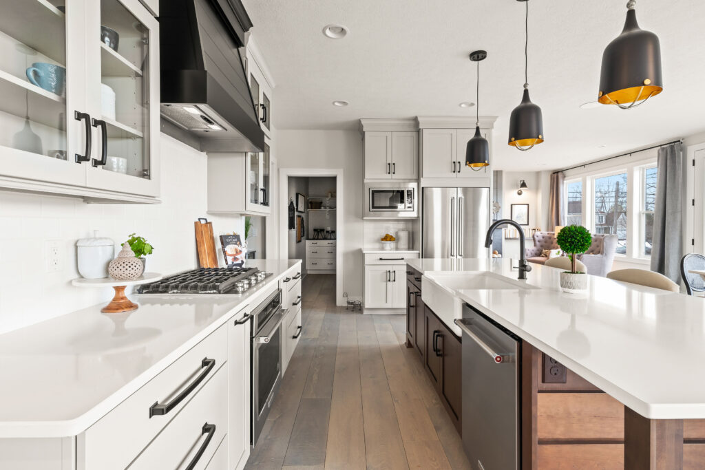 long black Berenson hardware in this farmhouse modern open floor plan kitchen that leads to a large walk in butler's pantry