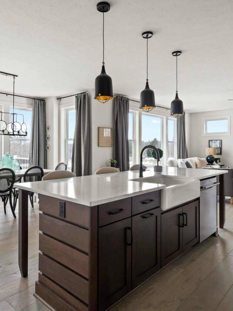 A modern farmhouse kitchen decorating ideas, an open floor plan kitchen with gray putty colored cabinets, a walnut wood ship lap island and white quartz countertops, modern walnut island